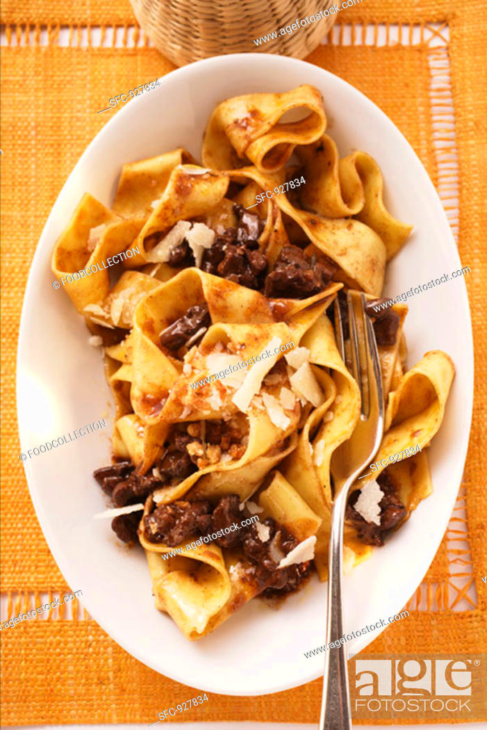 Stock Photo: Pappardelle with meat ragout with Barolo & Parmesan shavings.