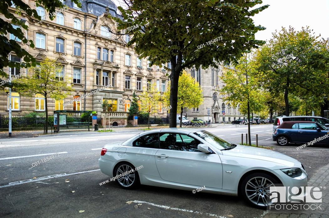Stock Photo: BMW car parked on pavement Strasbourg Alsace France.
