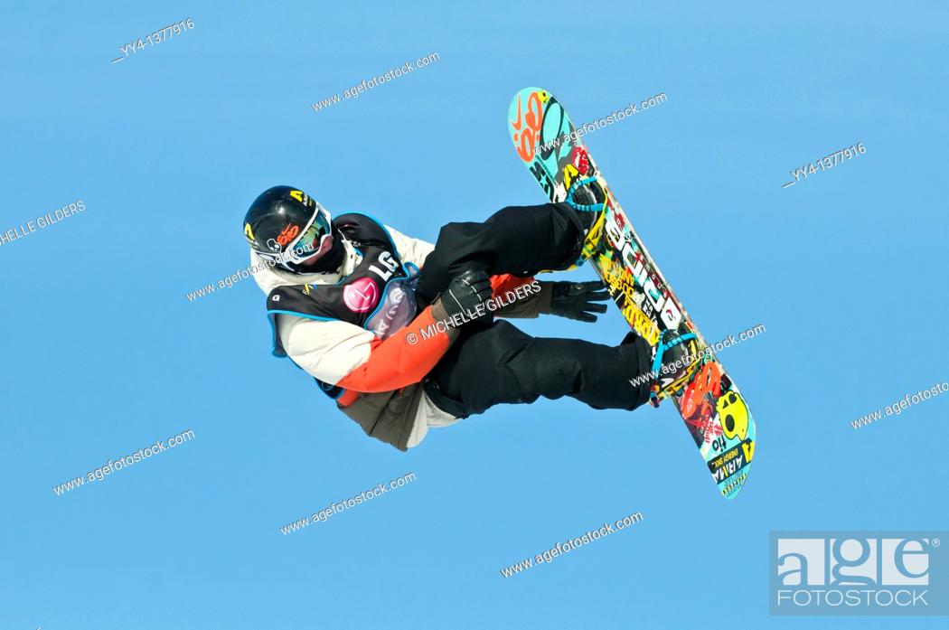 Stock Photo: Snowboarder at LG Snowboard FIS World Cup 2011, men's slopestyle event, Canada Olympic Park, Calgary, Alberta, Canada.
