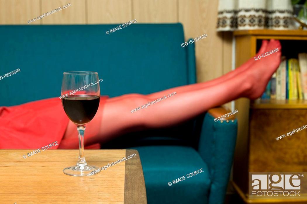Stock Photo: Woman lying on a sofa.