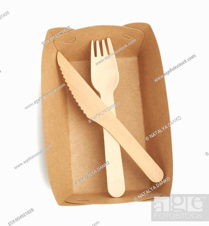 Stock Photo: paper plates from brown craft paper and wooden forks and knives isolated on a white background. Plastic rejection concept, zero waste.