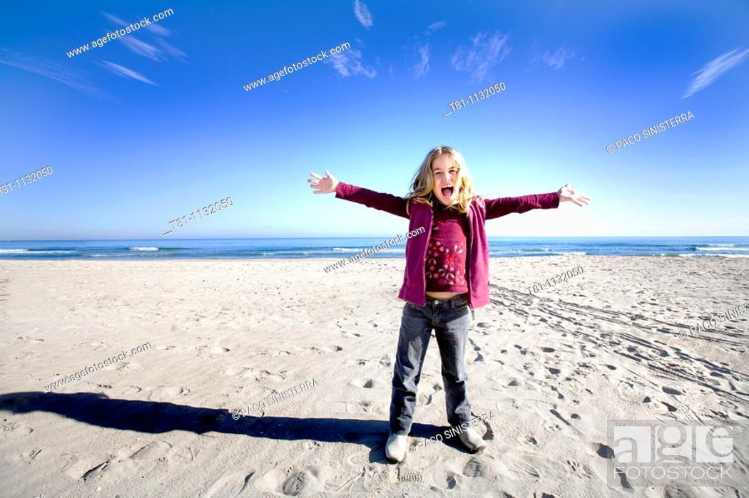 Stock Photo: blue sky blond girl alone.