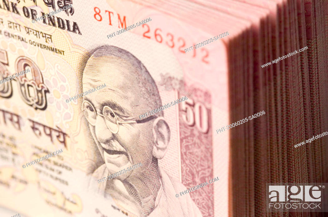 Stock Photo: Close-up of a picture of Mahatma Gandhi printed on Indian fifty rupee banknote.