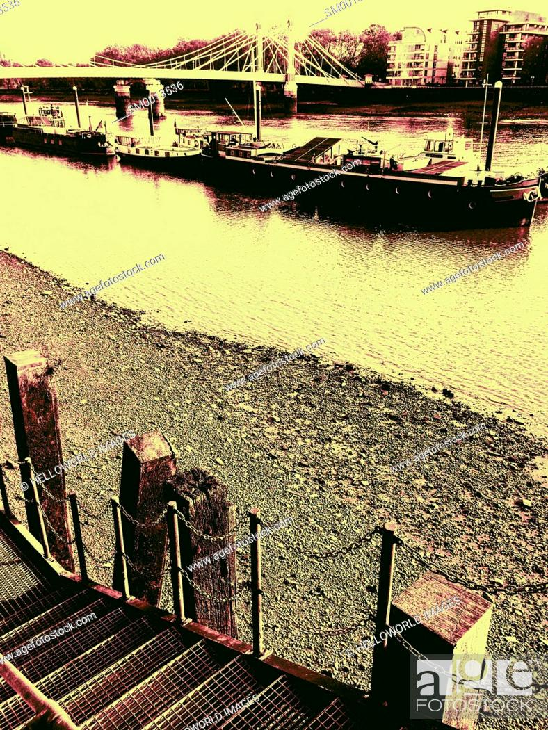 Stock Photo: Barges and houseboats on the river Thames by Albert Bridge, London, England.