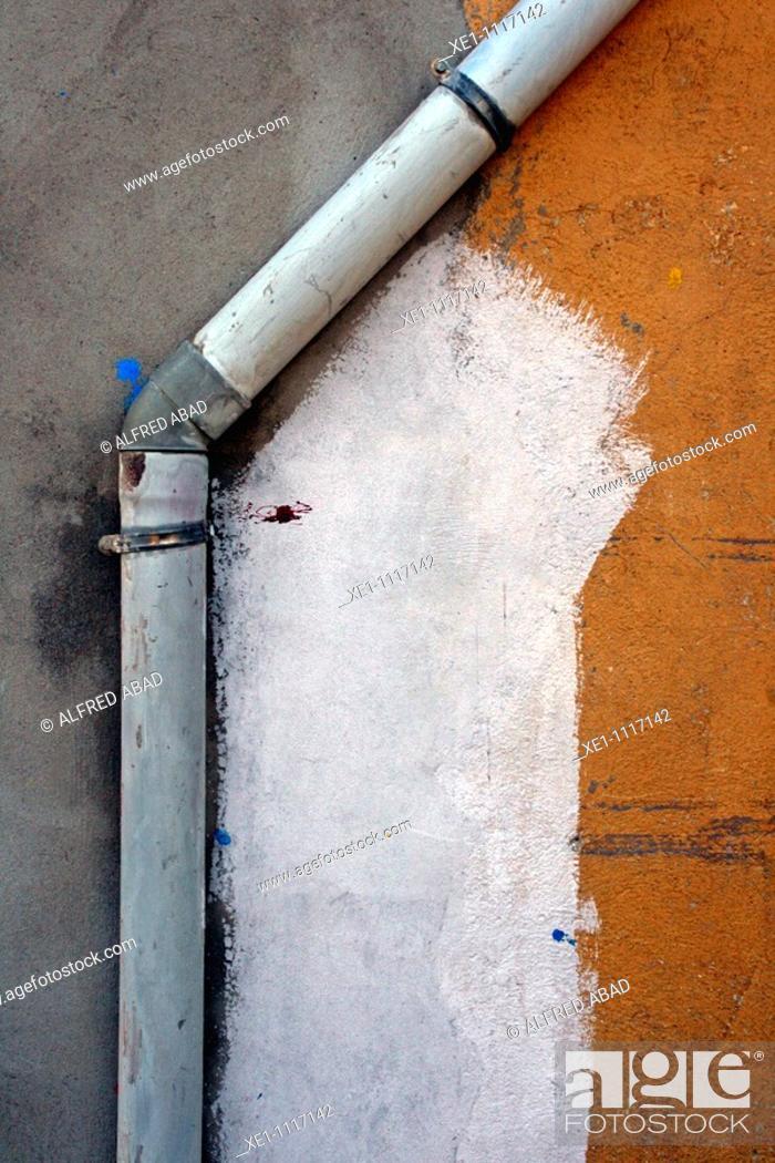 Stock Photo: Drain in painted wall, Súria, Catalonia, Spain.