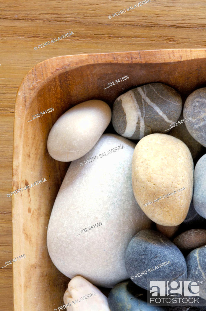 Stock Photo: Wooden bowl filled with stones.