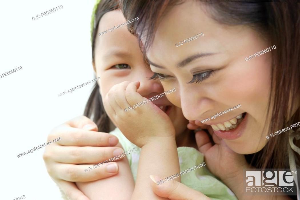Stock Photo: Woman and young girl indoors bonding.