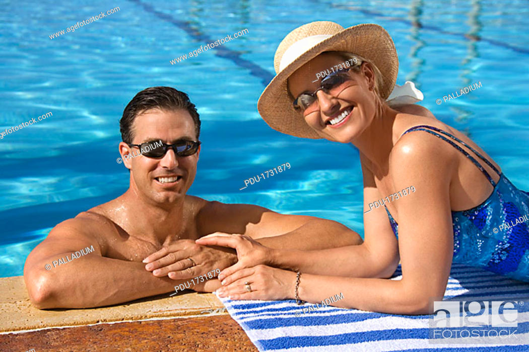 Stock Photo: Couple at pool.