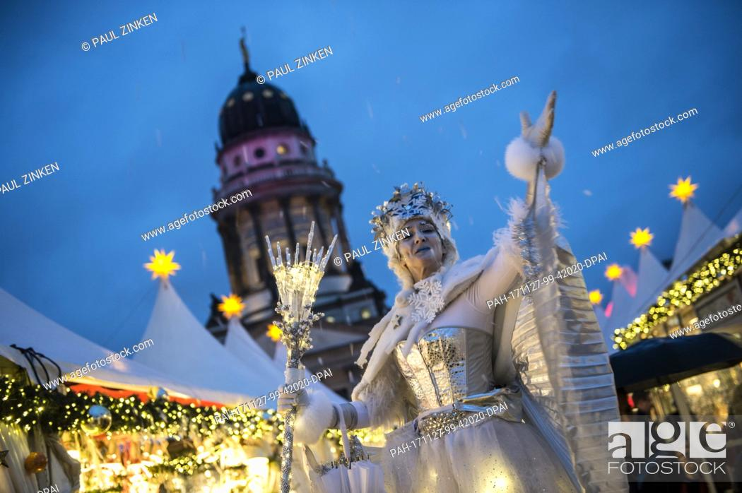 Stock Photo: The snow queen greets visitors at the Gendarmenmarkt Christmas market in Berlin, Germany, 27 November 2017. The Christmas market in front of the the Konzerthaus.