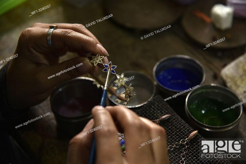 Stock Photo: Nagaon, Assam, India. February 11, 2019. Worker making silver jewellery in a traditional method in a Assamese jewellery manufacturing unit.
