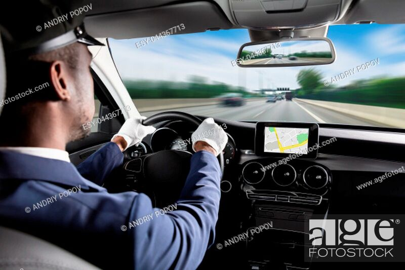 Stock Photo: Male Chauffeur Using GPS Navigation Driving Car.