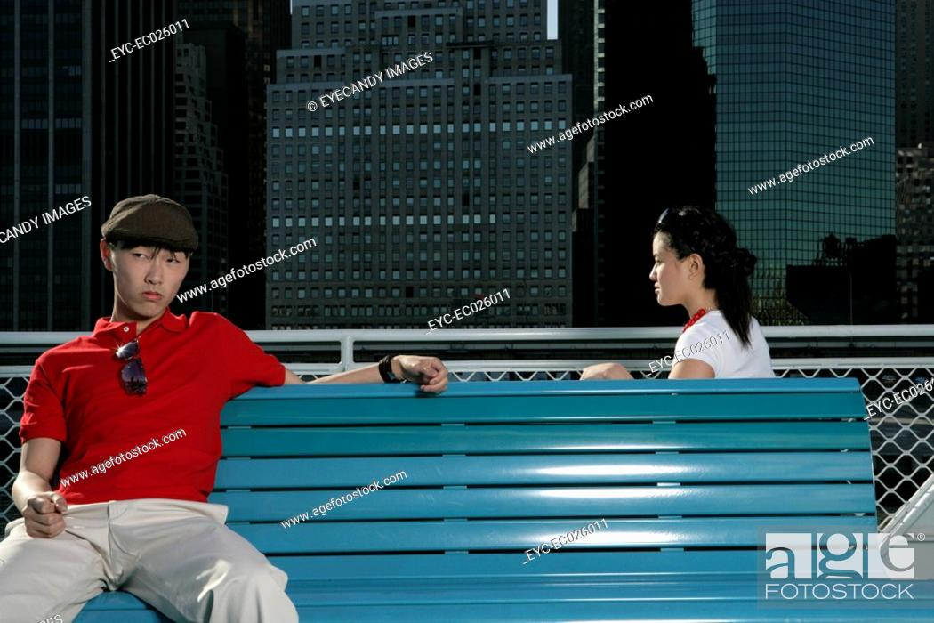 Stock Photo: Two people sitting on benches.
