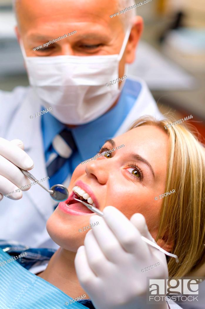 Stock Photo: White teeth woman patient at the dentist.