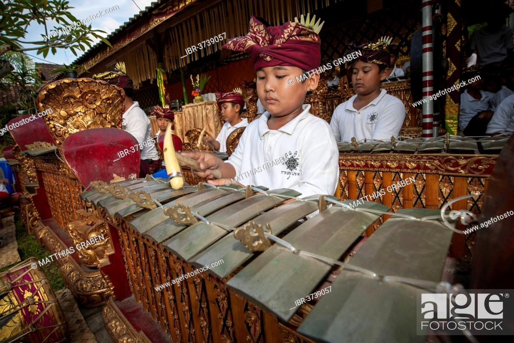 Stock Photo: Children of a gamelan orchestra at an event, Ubud, Bali, Indonesia.
