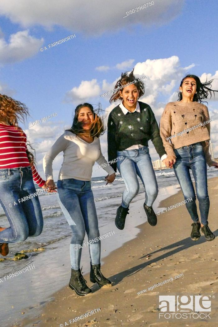 Stock Photo: TEL AVIV ISRAEL Young Arab girls hamming it up for the photographer on the beach.