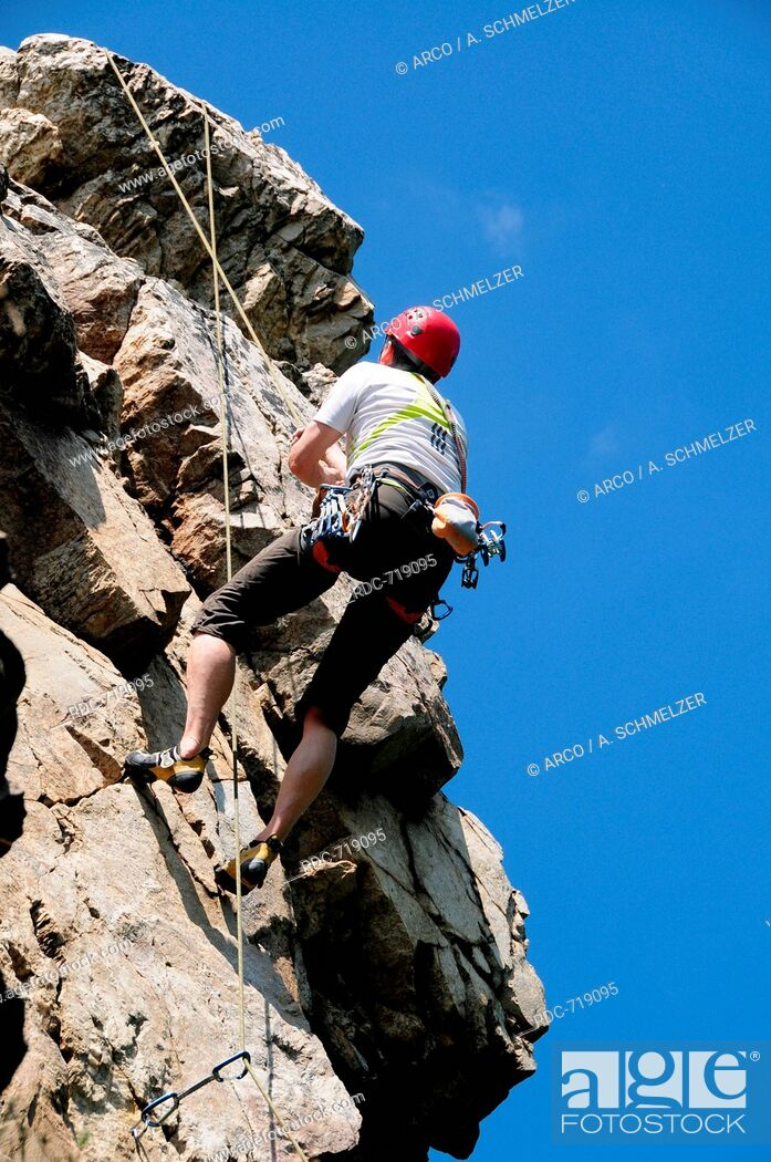 Stock Photo: Rock Climbing, abseiling, abseil, rappell, roping down.