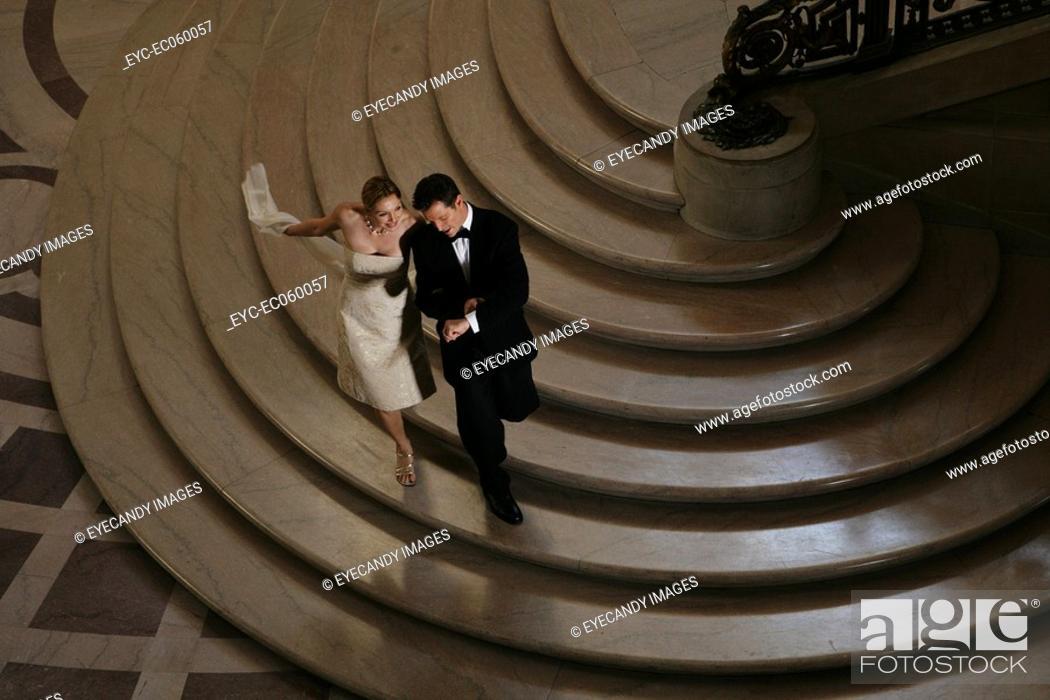 Stock Photo: Couple walking down a staircase.