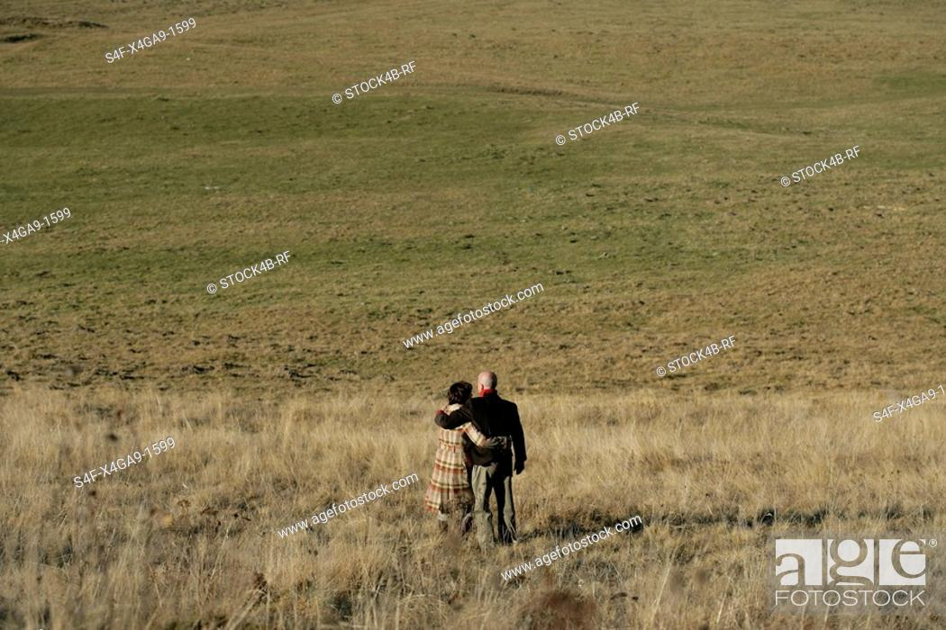 Stock Photo: Man and woman standing on a field.