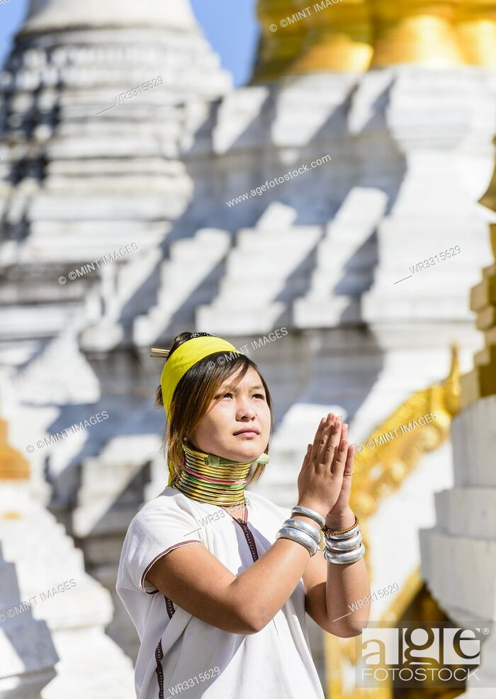 Stock Photo: Asian woman doing traditional dance at temple.