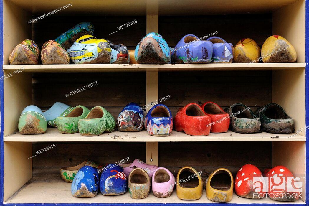 Stock Photo: Dirty clogs on shoe rack, Amsterdam, Netherlands.