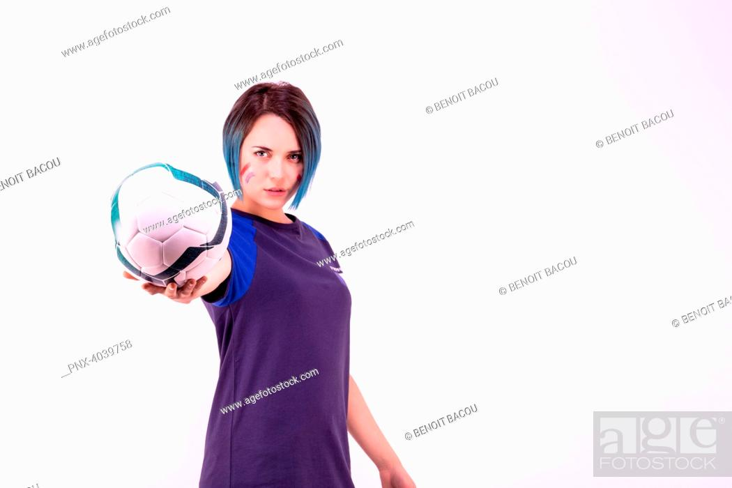 Stock Photo: Portrait of a young supporter of the France football team holding a ball in his hands.