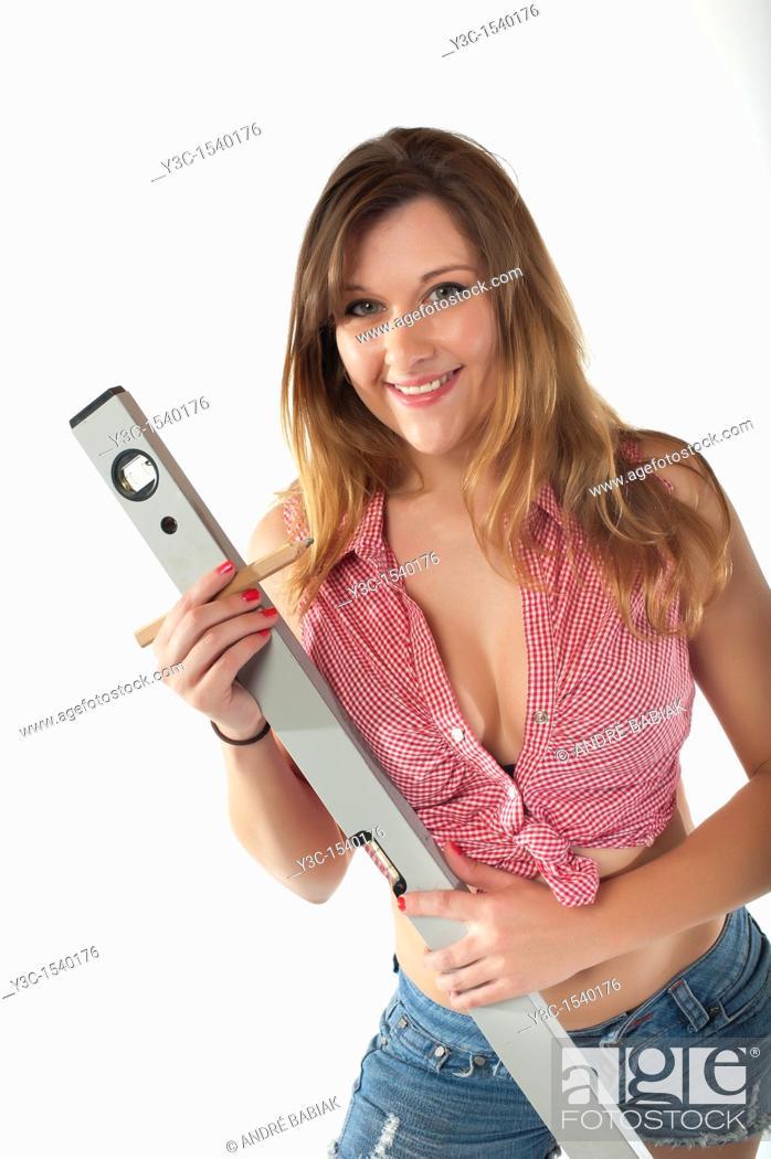 Stock Photo: Do it yourself female handyman.