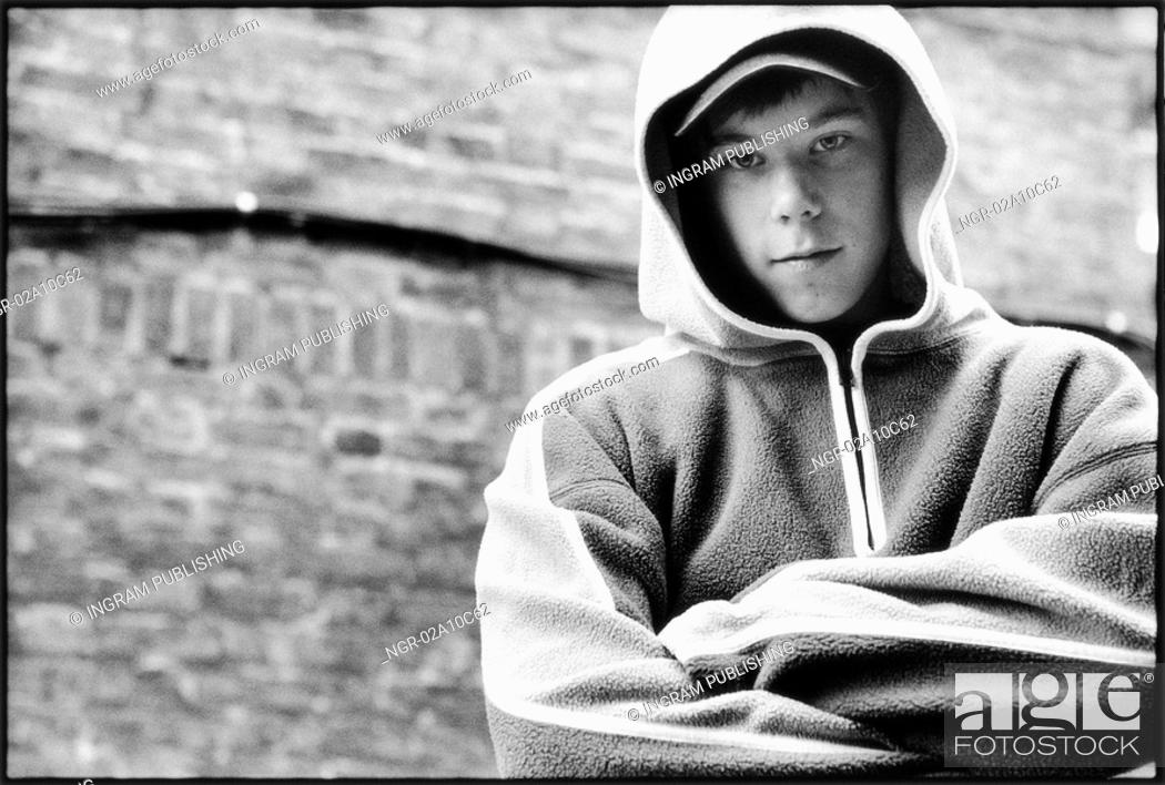 Stock Photo: teenager wearing hooded jacket.