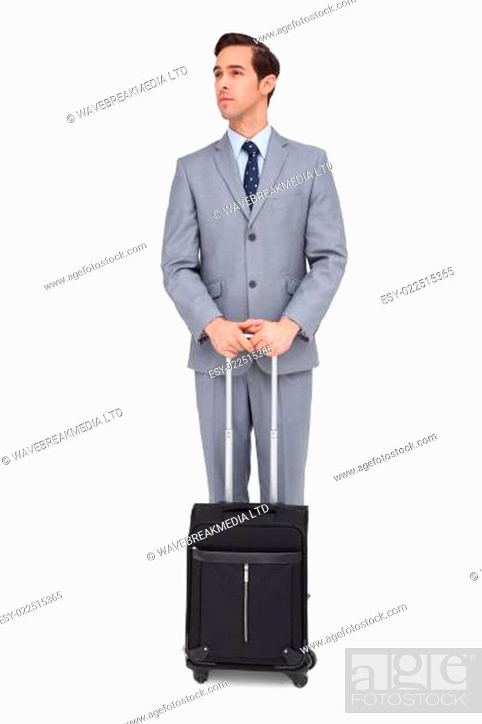 Stock Photo: Serious businessman waiting with his luggage.