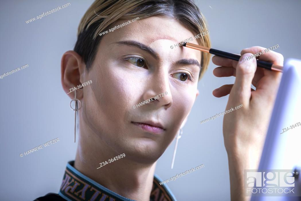 Stock Photo: Drag Queen doing makeup at home, Eindhoven, The Netherlands, Europe.