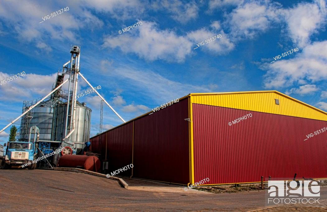 Stock Photo: Lithuania improvements industry farming with colorful company of wheat farming storage area with trucks in Vaunas Lithuania - 01/10/2015.