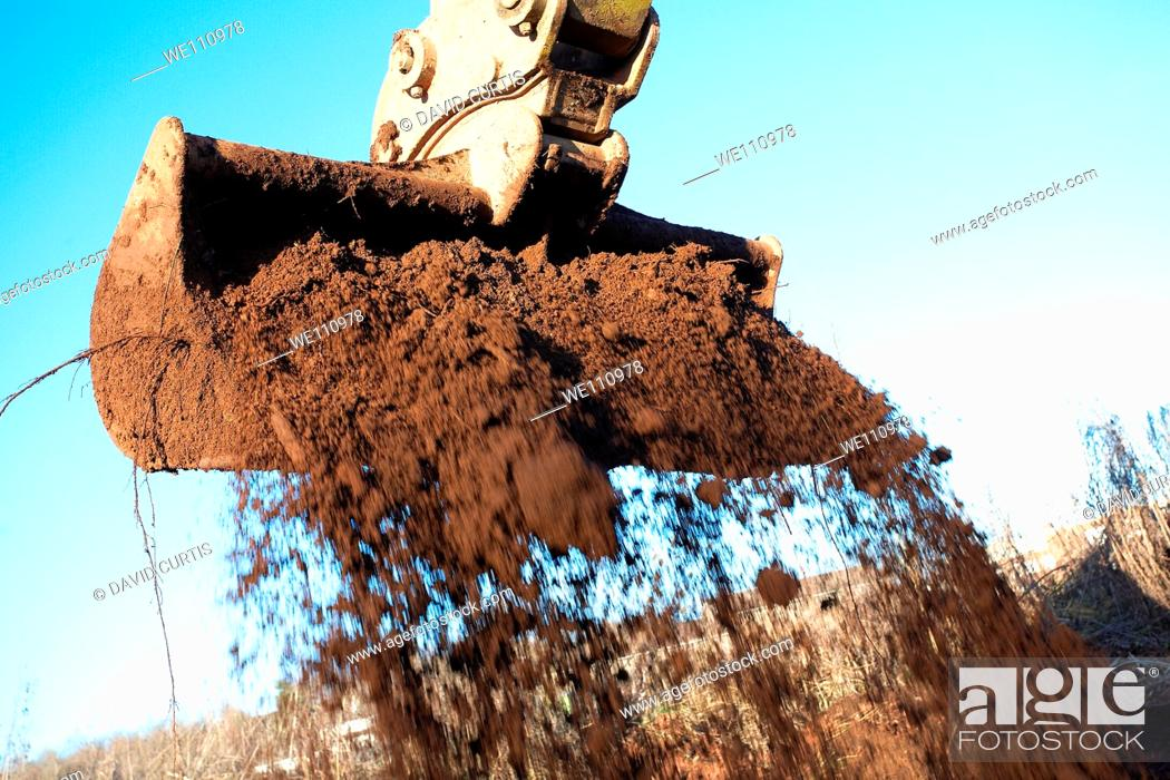 Stock Photo: Bucket of a job moving earth.