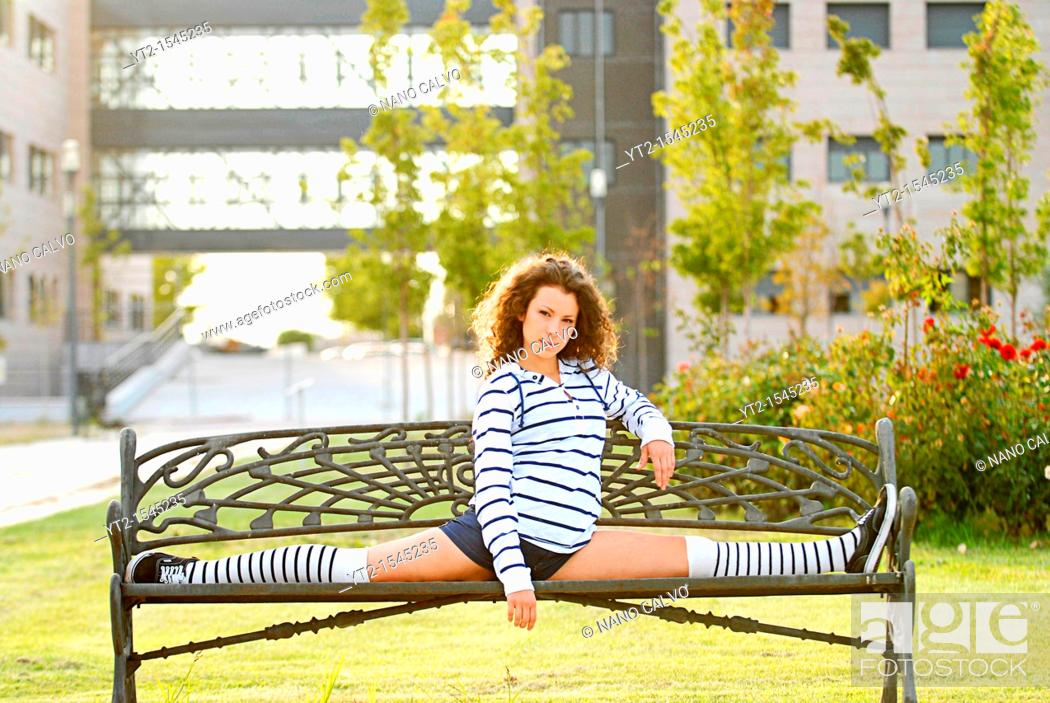Stock Photo: Cute young woman performing hard stretching exercise.