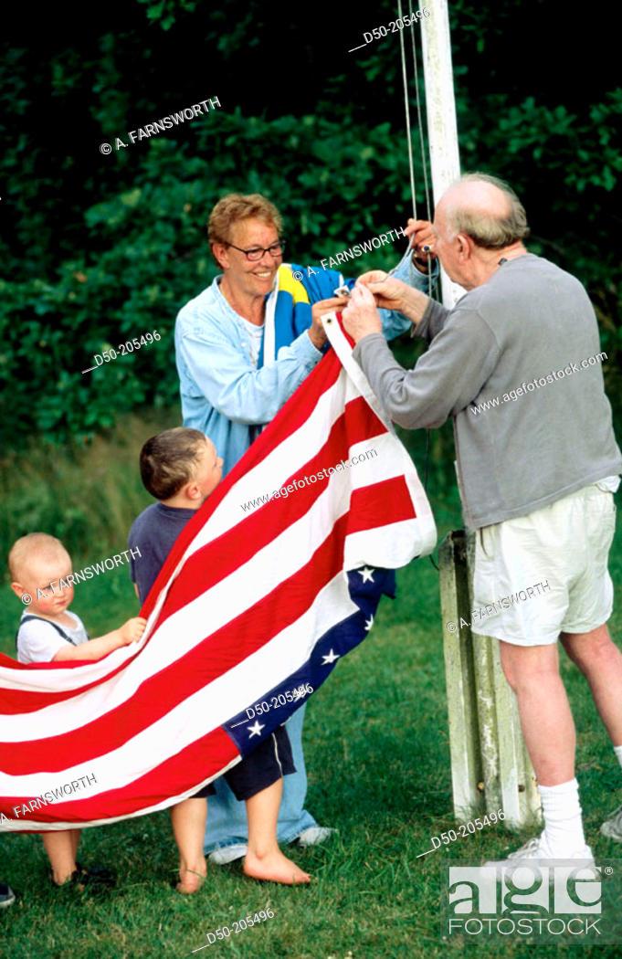Stock Photo: Raising US flag. Medevi. Sweden.