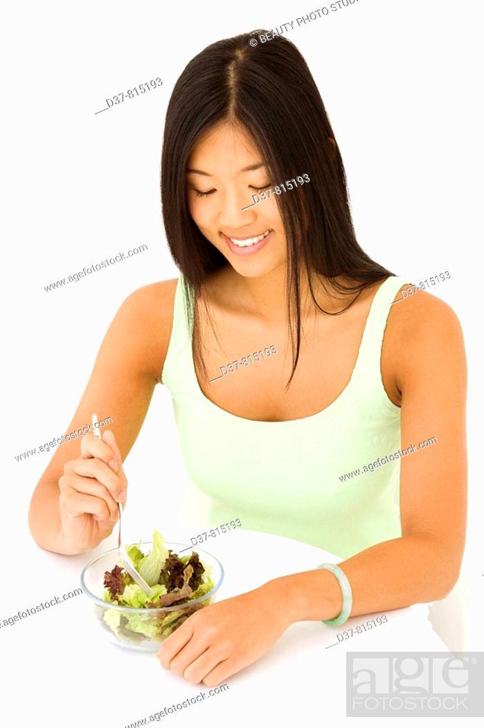 Stock Photo: Asian woman eating a green salad.