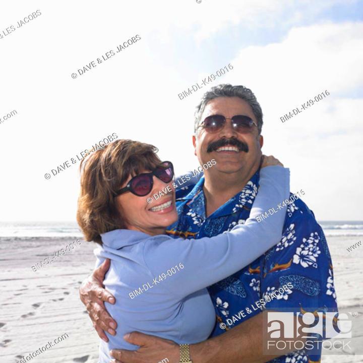 Stock Photo: Tourist couple hugging on the beach.