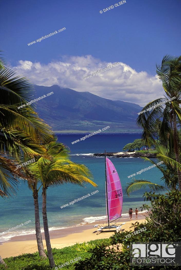 Stock Photo: Sailboat on the beach with the West Maui Mountains behind at Wailea Beach, Maui, Hawaii.