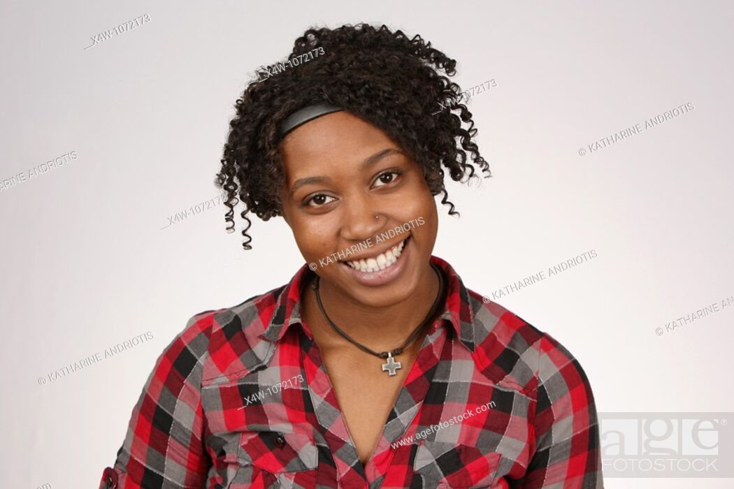 Stock Photo: Young African-American woman posing for portrait.