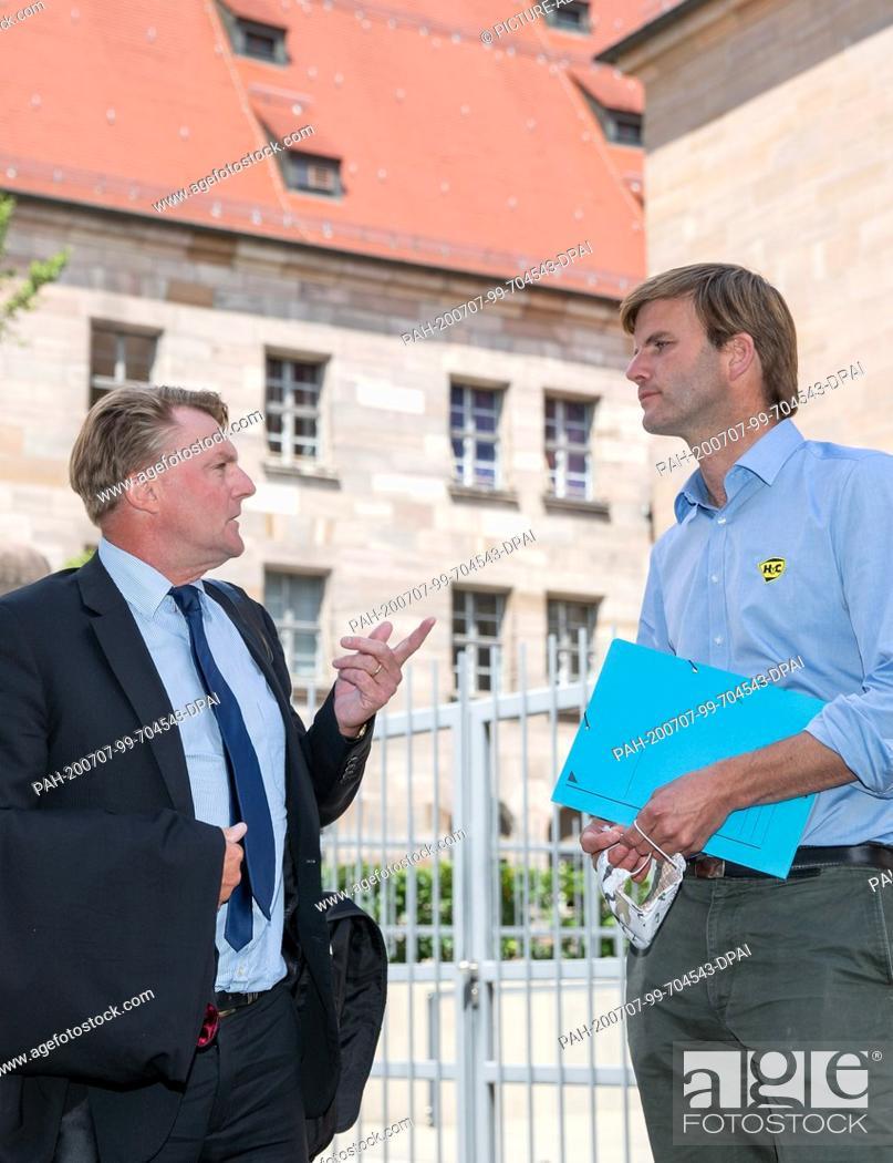 Stock Photo: 07 July 2020, Bavaria, Nuremberg: Hubertus Freiherr von Crailsheim (r) talks to his lawyer Ralf Bornhorst in front of the building of the Nuremberg-Fürth.