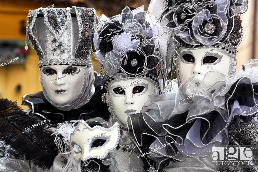 Stock Photo: The traditional Venice carnival where carnival-goers dress up in fine costumes and masks.
