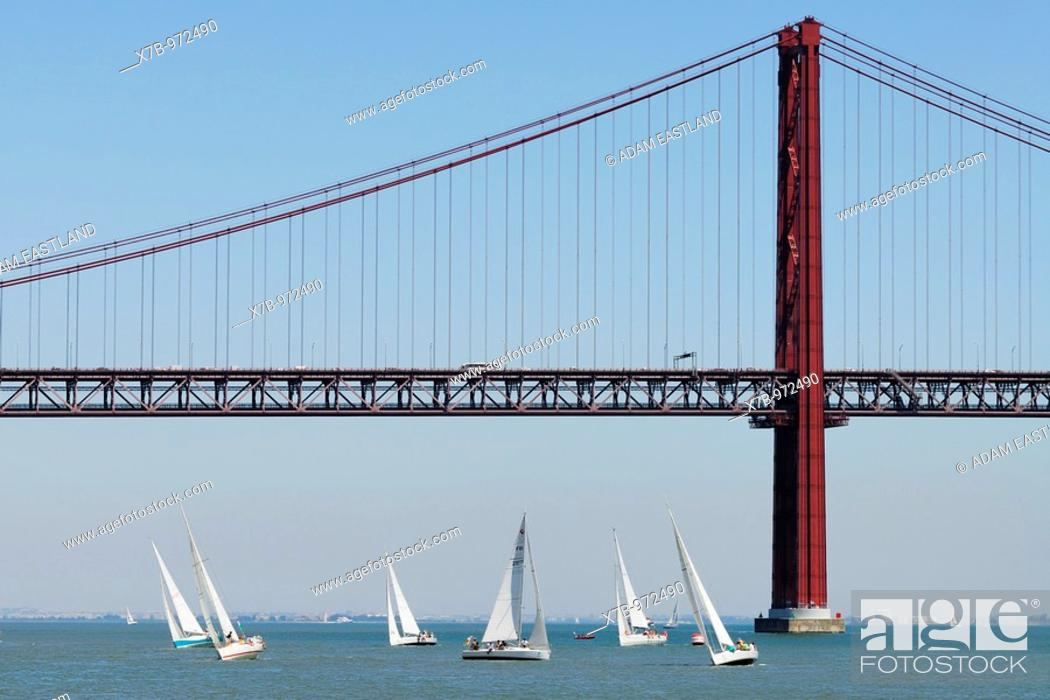 Stock Photo: Lisbon  Portugal  Yachts sailing on the Tagus River with the Ponte 25 de Abril in the background.