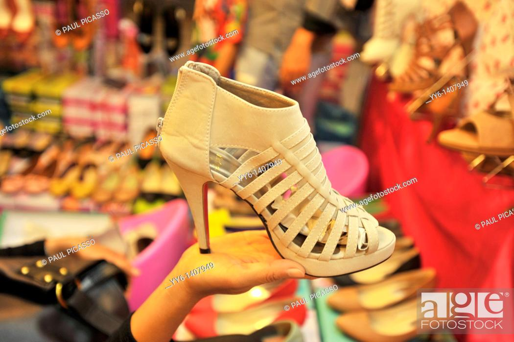 Stock Photo: shoes for sale , fashion mall, night time bazaar , bangkok, thailand.