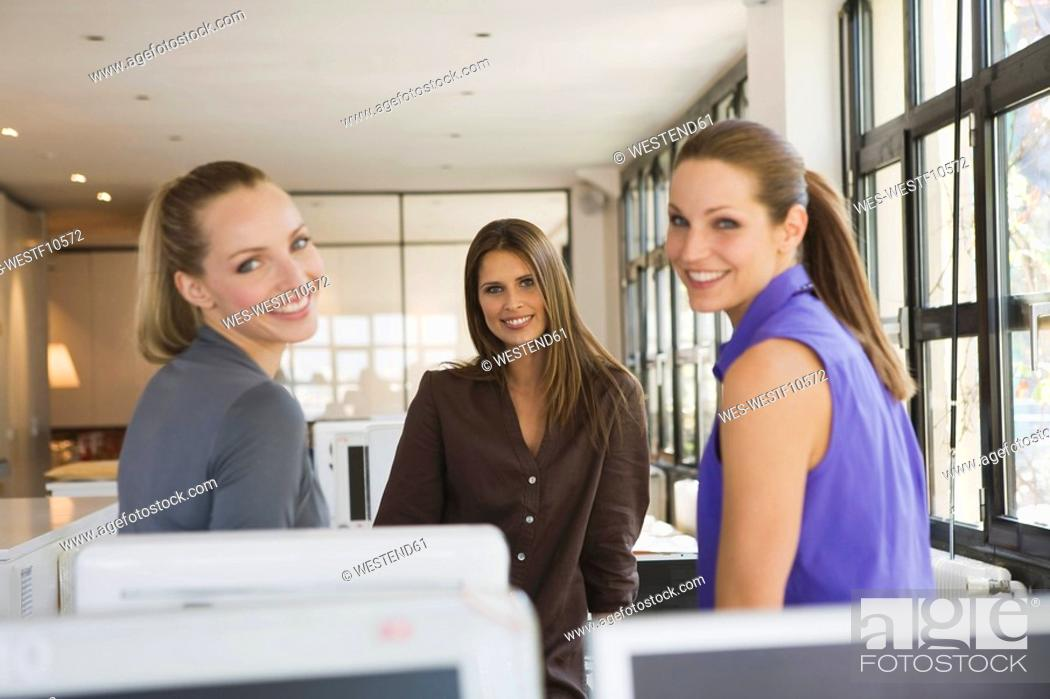 Stock Photo: Three women in office.