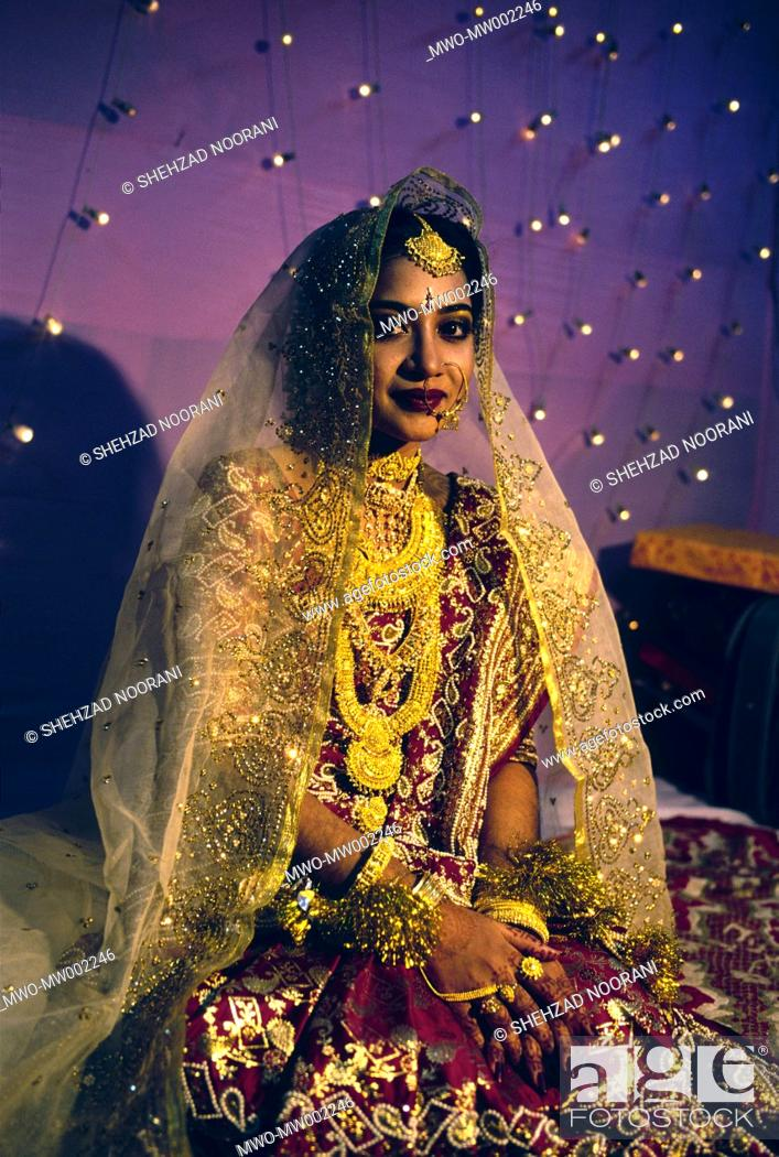 A Young Bengali Girl Wears Traditional Bridal Dress During Her