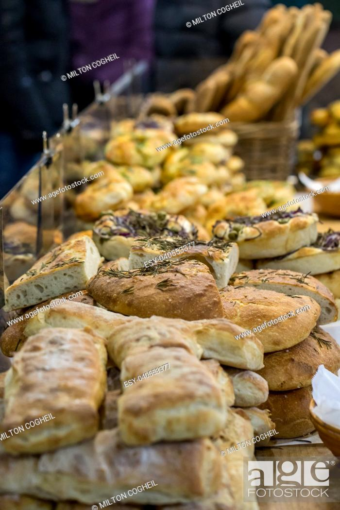 Stock Photo: Artisan bread on sale on a market stall in London.