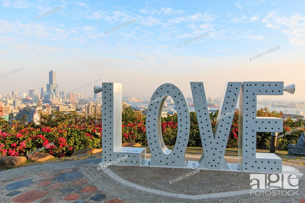 Stock Photo: Kaohsiung skyline at sunset with the Love sign.