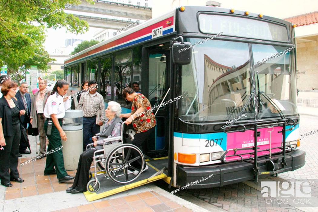Disabled resident boarding Miami-Dade Transit public bus