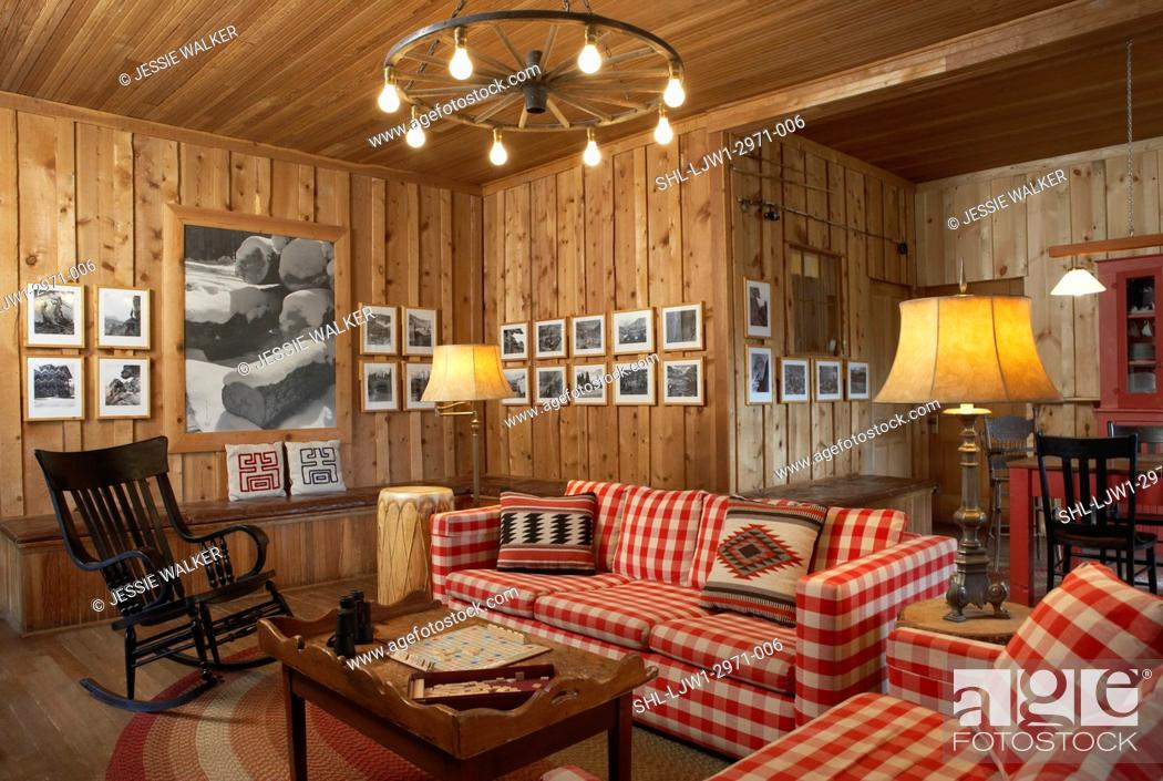 Stock Photo Living Room Casual Rustic Cabin In Colorado Red And White Checked Sofas Braided Rug Black Photos Hang On Knotty Pine Walls