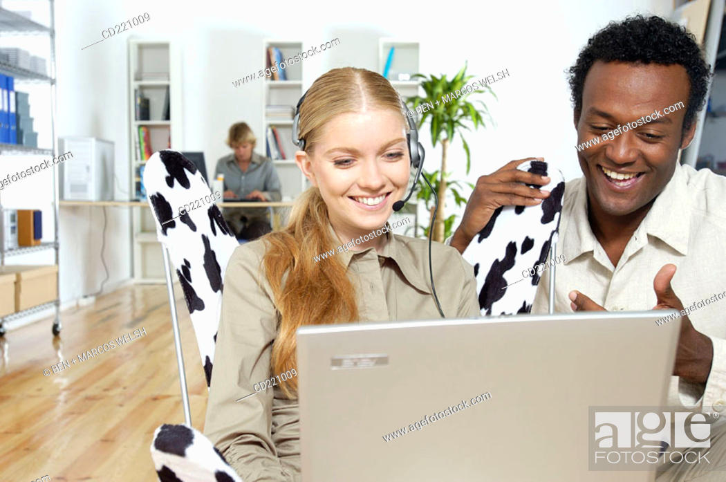 Stock Photo: Colleagues working in office.