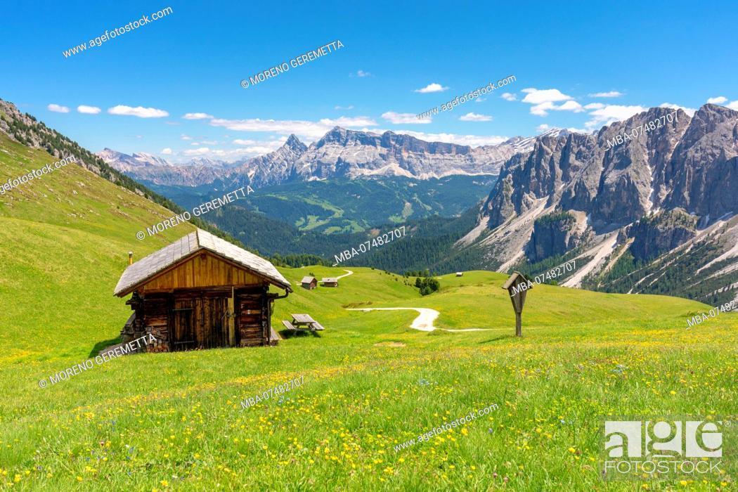 Stock Photo: Wooden hut in Medagles alp with Puez group on side and Sas dla Crusc Heiligkreuzkofel on the background, Dolomites, Lungiarü / Campill, San Martin de Tor.