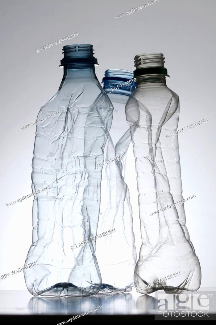 Stock Photo: Three empty, partially crushed plastic water bottles.
